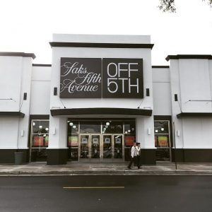 Shows teh front of Saks Fifth at the Outlets